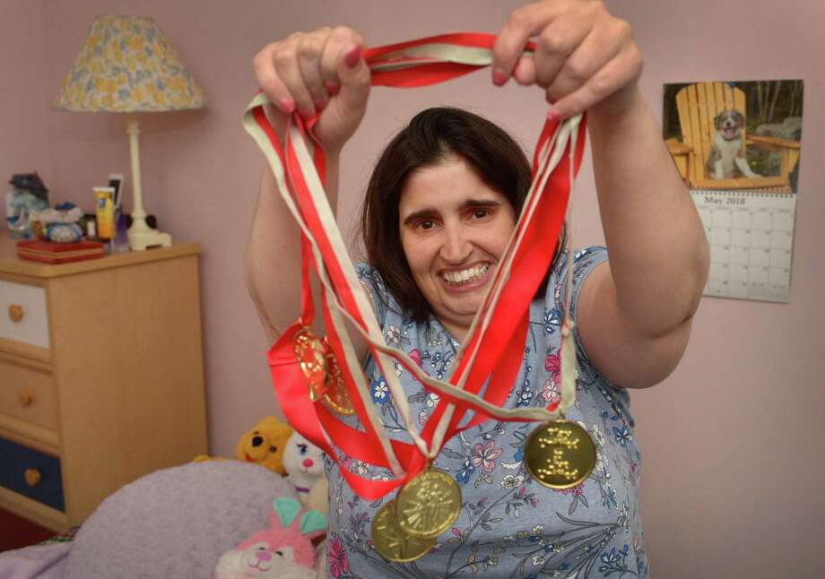 Gina Lopriore, an athlete training for the Special Olympics, Wednesday, May 9, 2018, at her parents home in Norwalk, Conn. Lopriore will be participating in the Southern Time Trials in Weston on Saturday. Photo: Erik Trautmann / Hearst Connecticut Media / Norwalk Hour