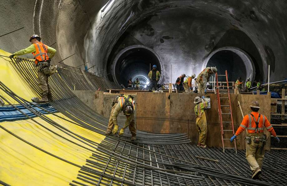 Workers construct the two main tunnels and platform location for the future Central Subway in Chinatown last month. Photo: Jessica Christian / The Chronicle
