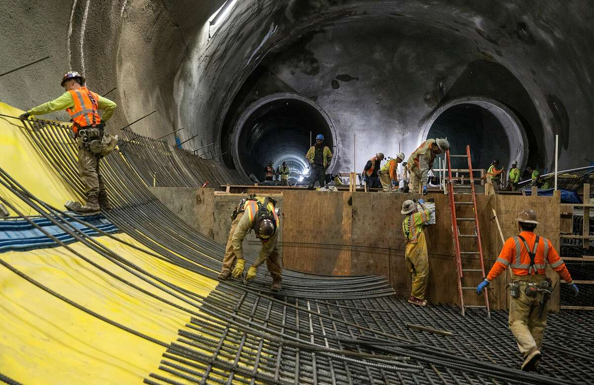 Workers continue construction on the two main tunnels and platform location for the future Central Subway near Stockton and Washington streets Tuesday, April 3, 2018 in San Francisco, Calif.