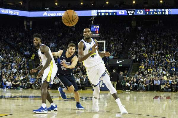 56f9affb8a1b 1of9Kevin Durant  35 of the Golden State Warriors catches a pass from  teammate Klay Thompson  11as he runs pasts a screen during the second  quarter of their ...