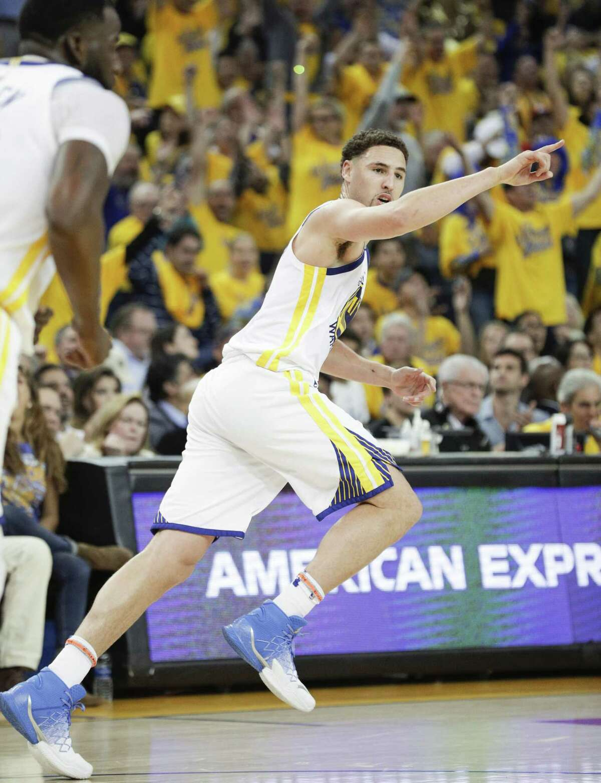 Golden State Warriors' Klay Thompson reacts after hitting a three-pointer in the second quarter during game 1 of round 2 of the Western Conference Finals between the Golden State Warriors and the New Orleans Pelicans at Oracle Arena on Saturday, April 28, 2018 in Oakland, Calif.