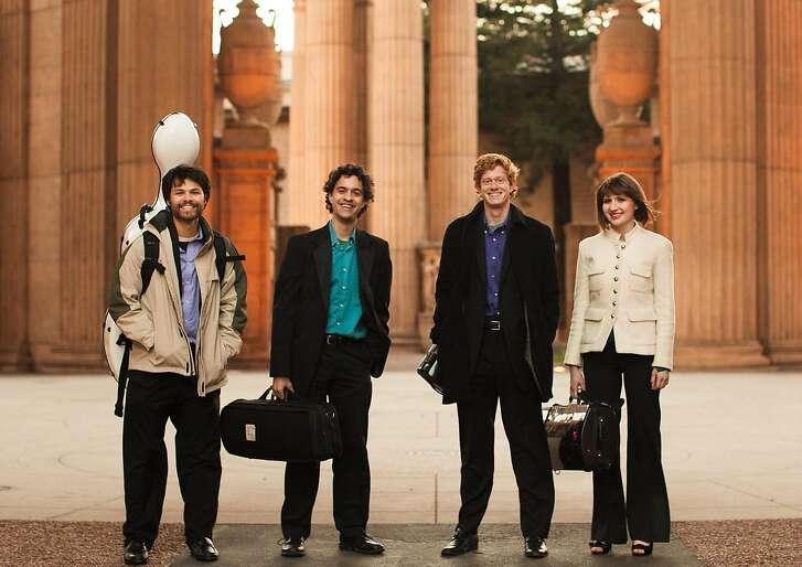 Friction Quartet: Cellist Doug Machiz (l.), violinists Otis Harriel and Kevin Rogers, violist Taija Warbelow