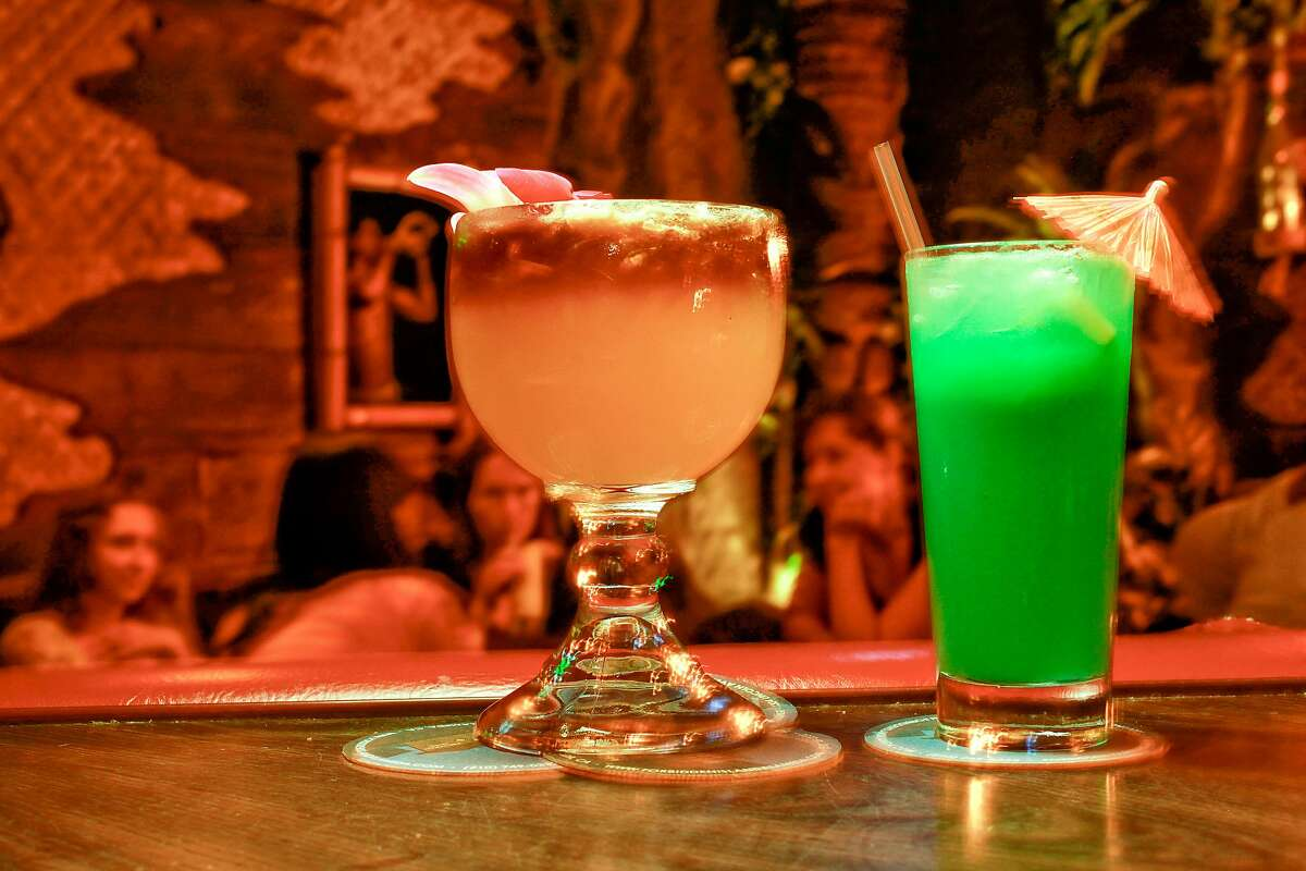 Specialty drinks, Island Mai Tai, (left) and a Neptune's Garden at the Fobbiden Island Tiki Lounge in Alameda, Calif. on Tuesday July 22, 2009.
