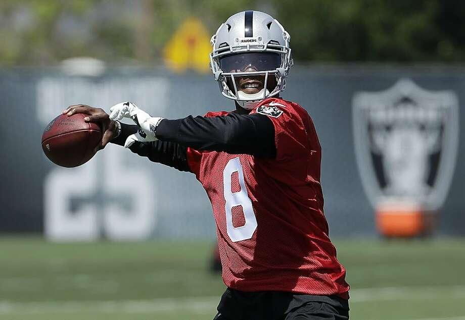 Oakland Raiders quarterback Josh Johnson passes during practice at the team's NFL football facility in Alameda, Calif., Tuesday, April 24, 2018. (AP Photo/Jeff Chiu) Photo: Jeff Chiu / Associated Press