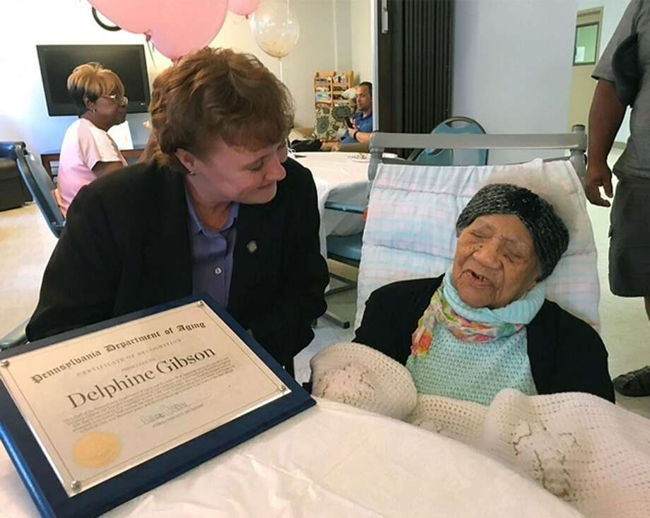 In this photo provided by Pennsylvania's Department of Aging, Delphine Gibson, right, is visited by Aging Secretary Teresa Osborne, at AristaCare Thursday, Aug. 17, 2017, in Huntingdon Park, Pa. Gibson, the oldest known living person in the United States celebrated her 114th birthday on Thursday in Pennsylvania. (Drew Wilburne/Pennsylvania Department of Aging via AP) Photo: Drew Wilburne/Pennsylvania Department Of Aging Via AP