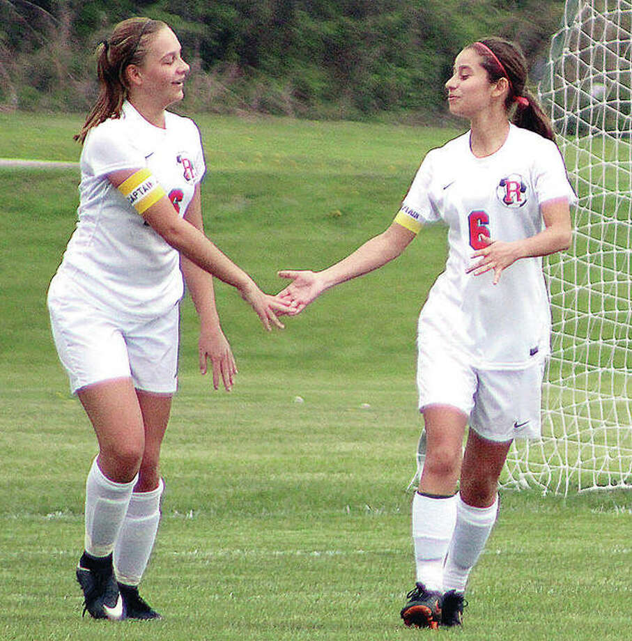 Emma Lucas, left, and teammate Mykala Rosales congratulate each other after teaming up for a goal earlier this season. The Shells will face Wesclin at 4:30 p.m. Friday in the title game of the Breese Central Regional. Photo:       Pete Hayes | The Telegraph