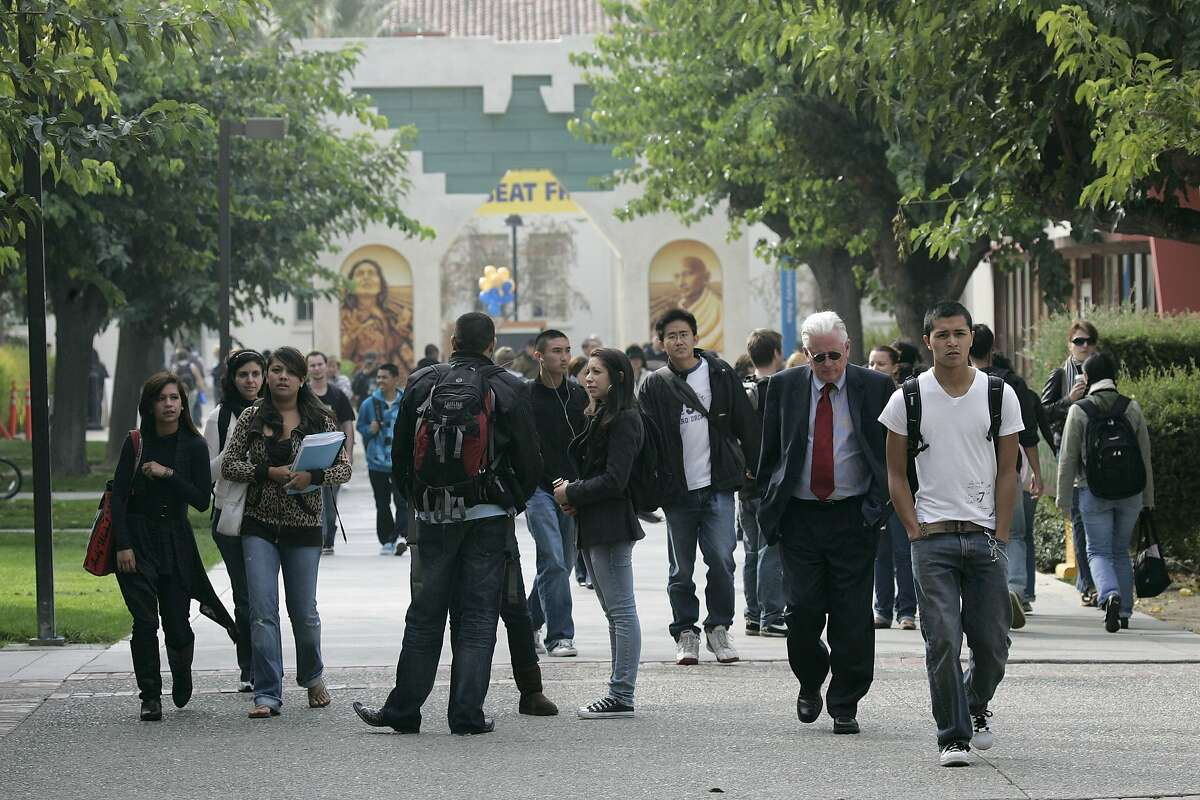 In this Nov. 19, 2008 file photo, students walk on the campus of San Jose State University in San Jose, Calif.