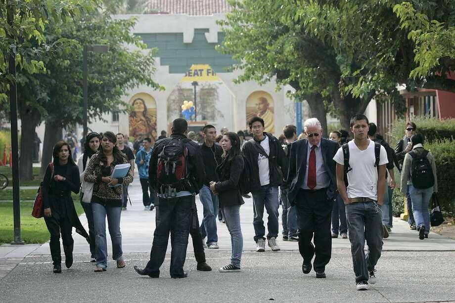 In this Nov. 19, 2008 file photo, students walk on the campus of San Jose State University in San Jose, Calif. (AP Photo/Marcio Jose Sanchez, file) Photo: Marcio Jose Sanchez / AP