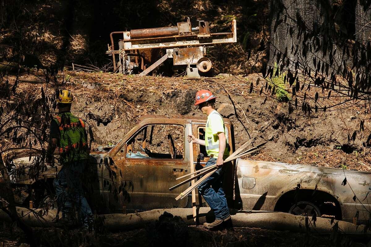 Construction crew begin working to set a perimeter around the complex debris removal site in Santa Rosa, Calif., Monday, April 23, 2018.