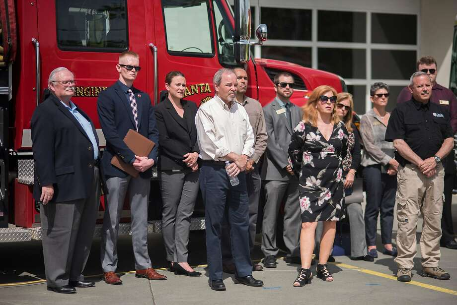 Mark Ghilarducci of the Governor's Office of Emergency Services (right) is among the officials from various state, local and federal agencies speaking to the media in Santa Rosa about the Northern California wildfire cleanup. Photo: Brian L. Frank / Special To The Chronicle