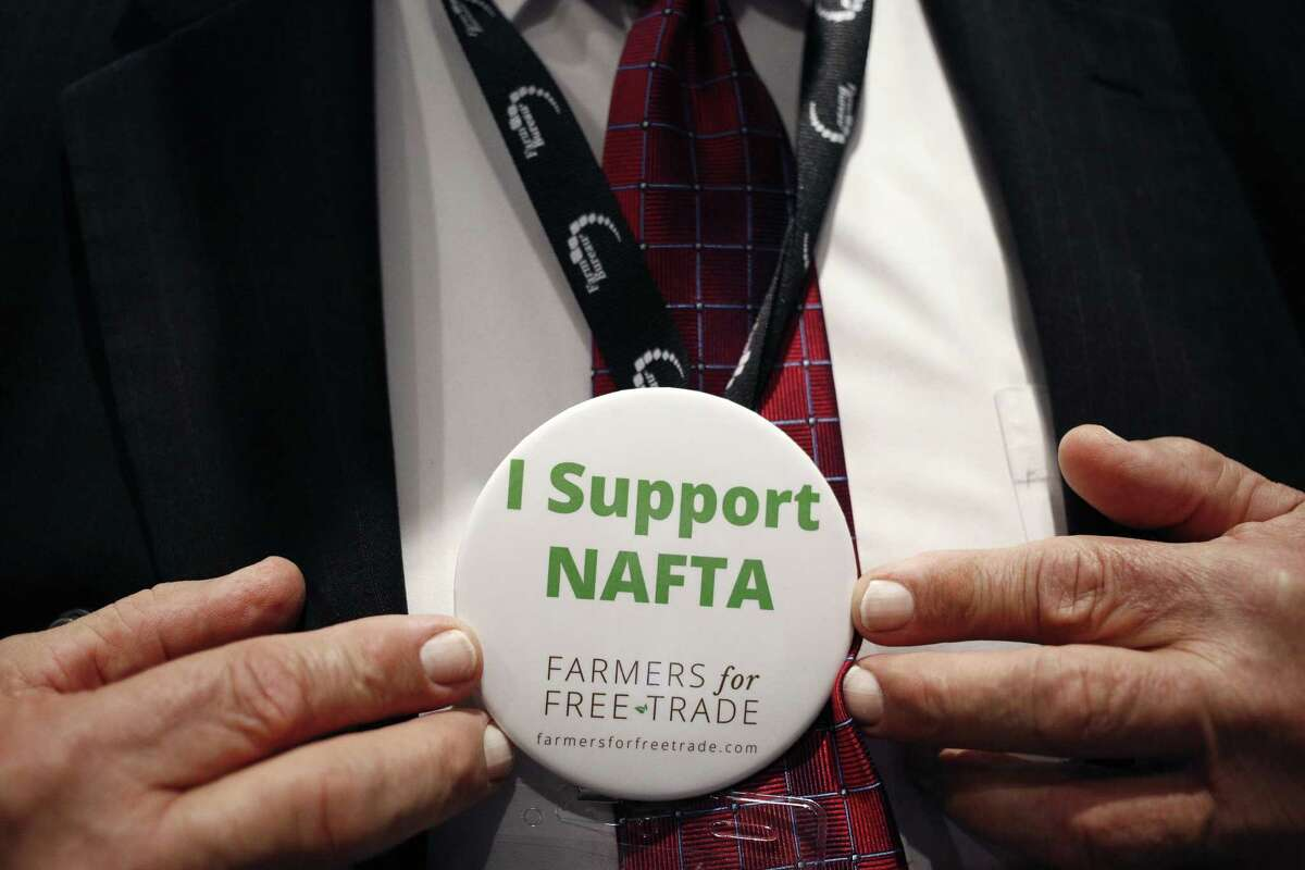 """An attendee displays an """"I Support NAFTA"""" button for a photograph during the annual American Farm Bureau Federation conference in Nashville, Tenn., on Jan. 8, 2018. MUST CREDIT: Bloomberg photo by Luke Sharrett"""