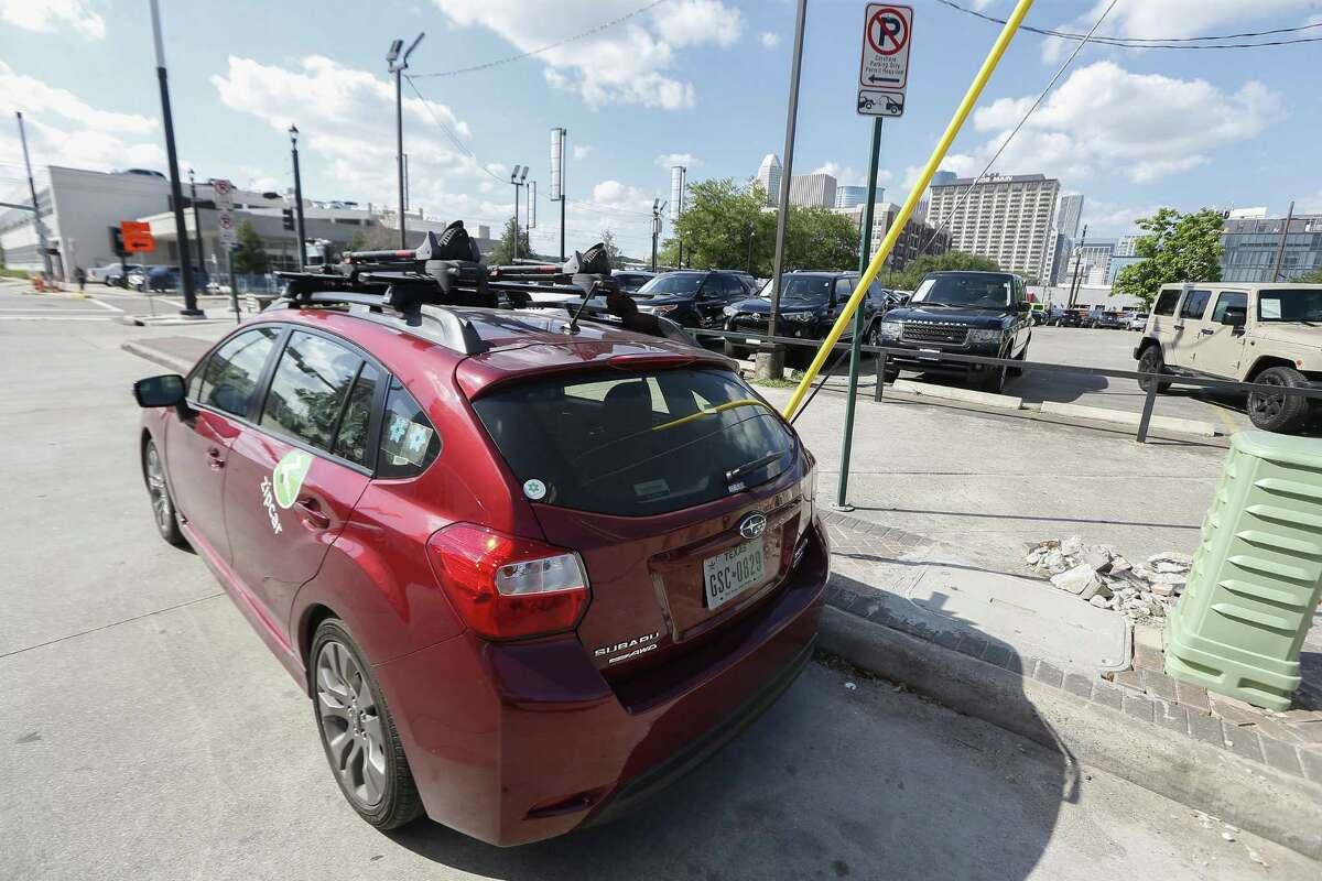 """A Subaru Impreza Zipcar with a bike rack, named """"Interstate"""" is seen parked at McGowen and Main on May 10."""