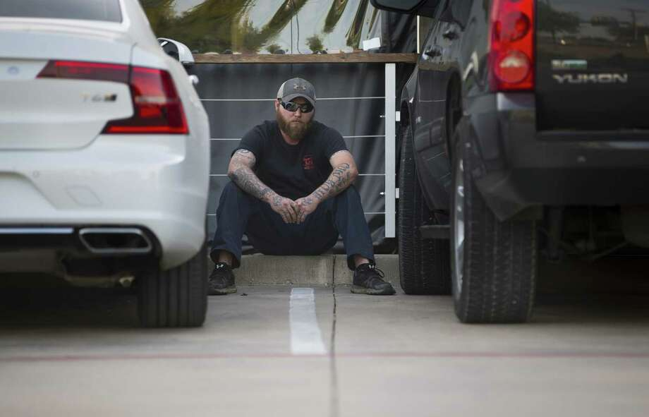 Cody Ledbetter, a former member of the Cossacks motorcycle club, on Wednesday, April 18, 2018, sitting in the spot where his stepfather, Danny Boyett, died after being shot in the head on May 17, 2015 in the parking lot of a former a Twin Peaks restaurant in Waco. Ledbetter describes knowing that his father was dead because of the severity of his wounds which Ledbetter saw as he was walked out by police and taken into custody following the shoot out. Nine people died in the shootout. Photo: Mark Mulligan / © 2018 Houston Chronicle