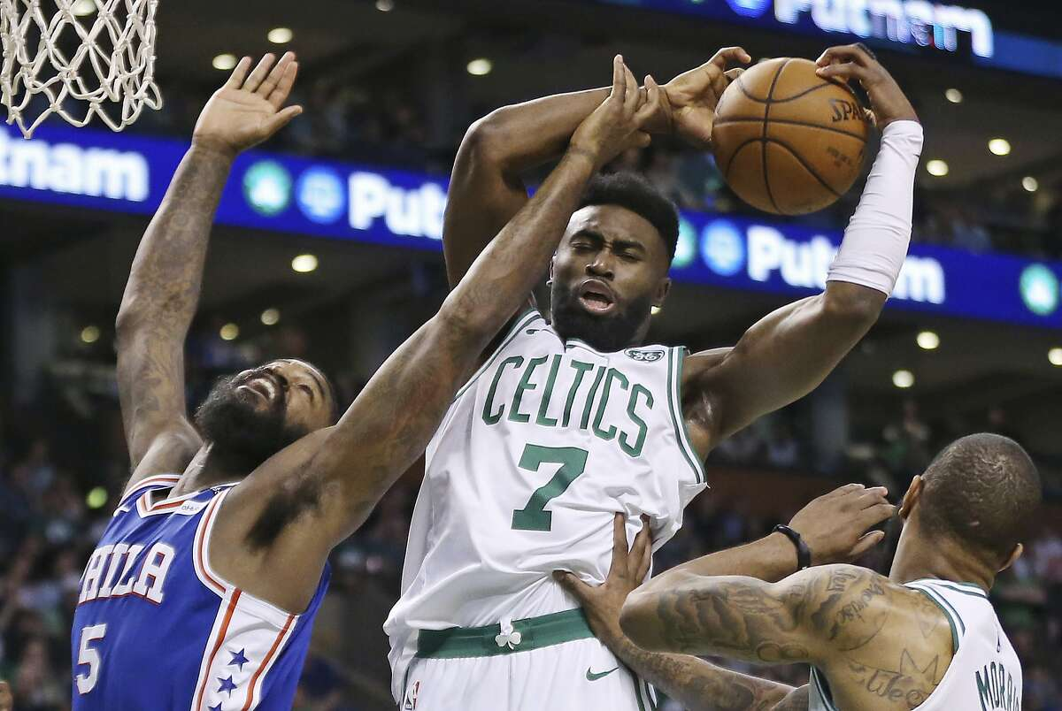 Boston Celtics guard Jaylen Brown (7) pulls down a rebound over Philadelphia 76ers center Amir Johnson (5) during the first quarter of Game 2 of an NBA basketball second-round playoff series Thursday, May 3, 2018, in Boston. (AP Photo/Elise Amendola)