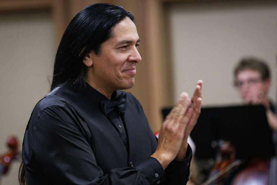 Alfredo Olivera de la Vega, Music Director/Conductor, applauds during the Conroe Symphony Youth Orchestra Christmas Concert on Sunday, Dec. 17, 2017, at the Conroe Symphony Centre. The spring Conroe Symphony Youth Orchestra concert is this Sunday, May 13, at 5 p.m. at the Symphony Centre. Photo: Michael Minasi, Staff Photographer / © 2017 Houston Chronicle