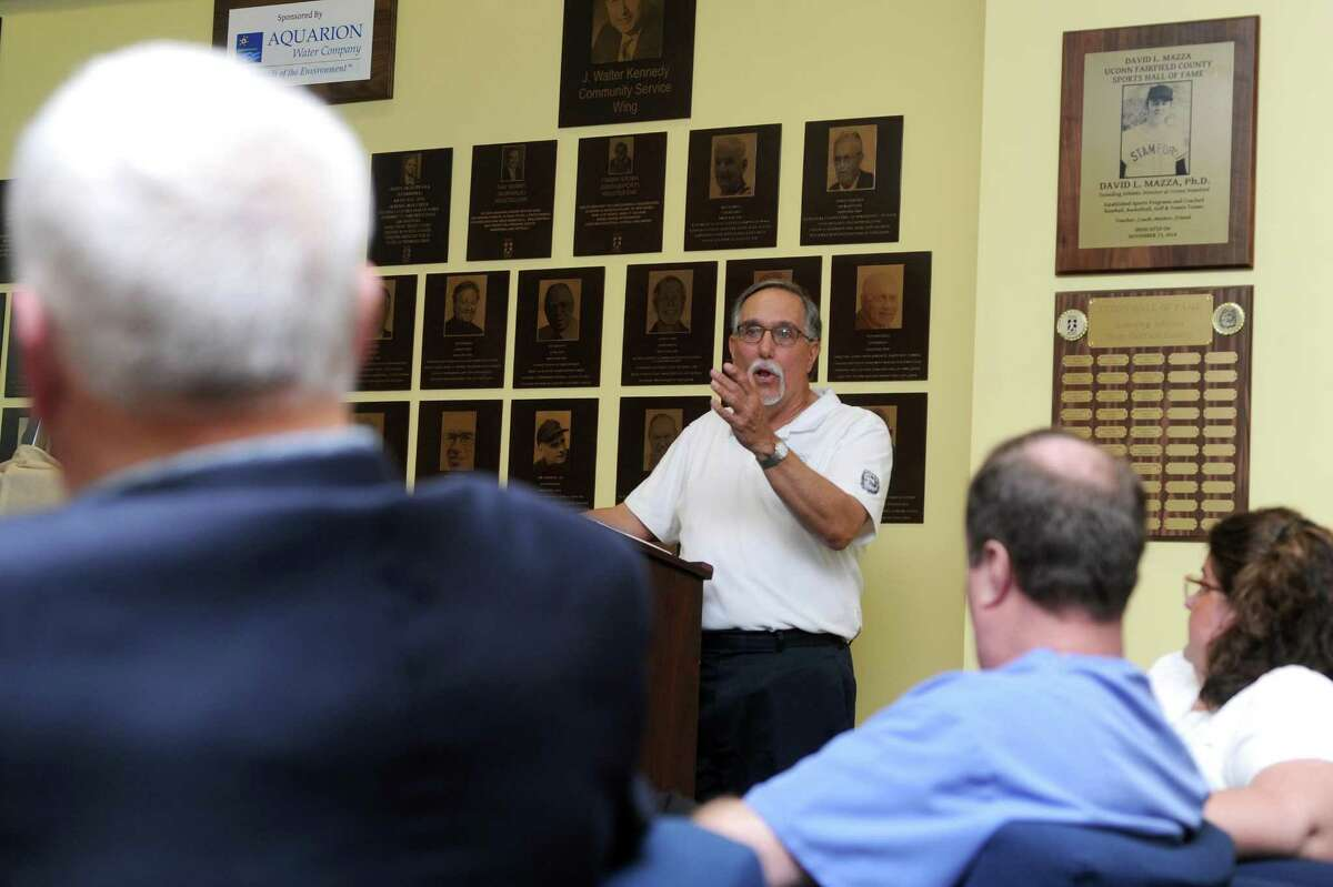 Fairfield County Sports Commission executive director Tom Chiappetta speaks about the honored athletes during the plaque unveiling ceremony for the 2017 inductees into the Fairfield County Hall of Fame inside UConn Stamford in downtown Stamford, Conn. on Thursday, May 10, 2018.