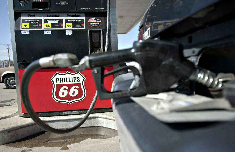 A Phillips 66 logo is seen on a gas pump as a car is filled a Beck's station in Princeton, Illinois, U.S., on Monday, March 5, 2012. Prices have increased 15 percent this year and are 7.8 percent higher than a year earlier. Photographer: Daniel Acker/Bloomberg Photo: Daniel Acker / Bloomberg / © 2012 Bloomberg Finance LP