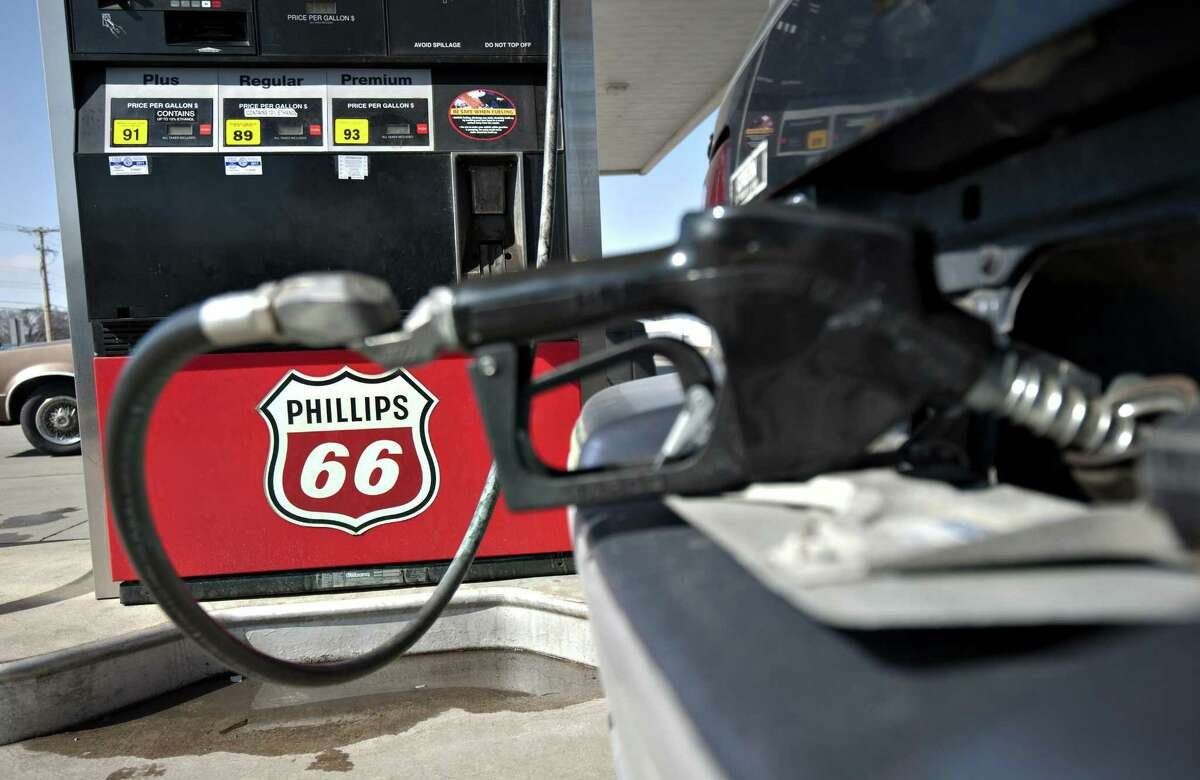 A Phillips 66 logo is seen on a gas pump as a car is filled a Beck's station in Princeton, Illinois, U.S., on Monday, March 5, 2012. Prices have increased 15 percent this year and are 7.8 percent higher than a year earlier. Photographer: Daniel Acker/Bloomberg