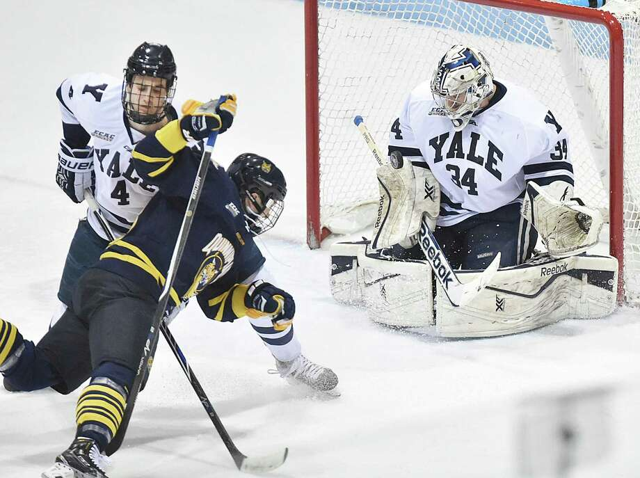 Former Yale goalie Alex Lyon finished with 94 saves in an American Hockey League playoff game that stretched to seven periods and 146 minutes, 48 seconds of play. Photo: Catherine Avalone / Hearst Connecticut Media File Photo / Catherine Avalone/New Haven Register