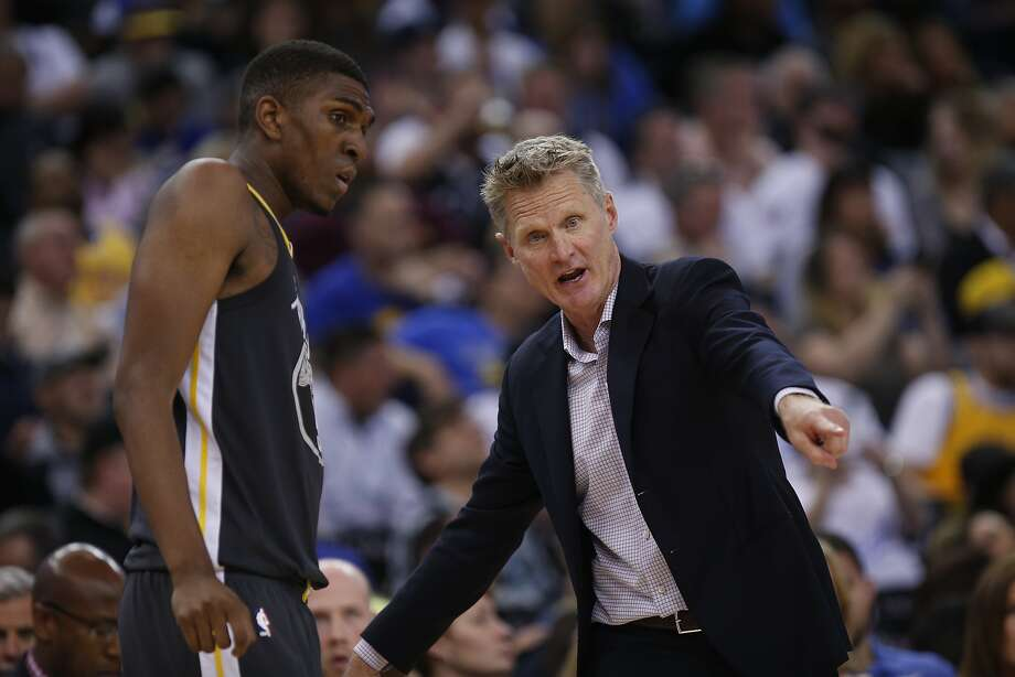 Golden State Warriors head coach Steve Kerr (right) speaks with Kevon Looney during an NBA game between the Warriors and New Orleans Pelicans at Oracle Arena on Saturday, April 7, 2018, in Oakland, Calif. The Warriors lost 126-120. Photo: Santiago Mejia / The Chronicle