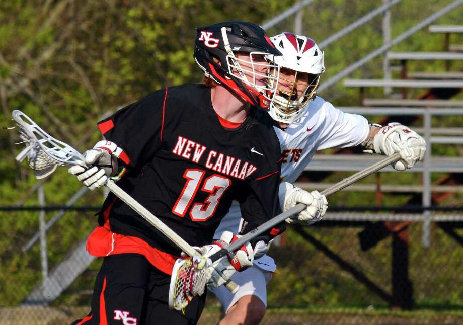 St. Joseph's Brandon Zimnoch, right, tries to stop a drive to the goal by New Canaan's Zachary Miller during Thursday's contest. Photo: Christian Abraham / Hearst Connecticut Media / Connecticut Post