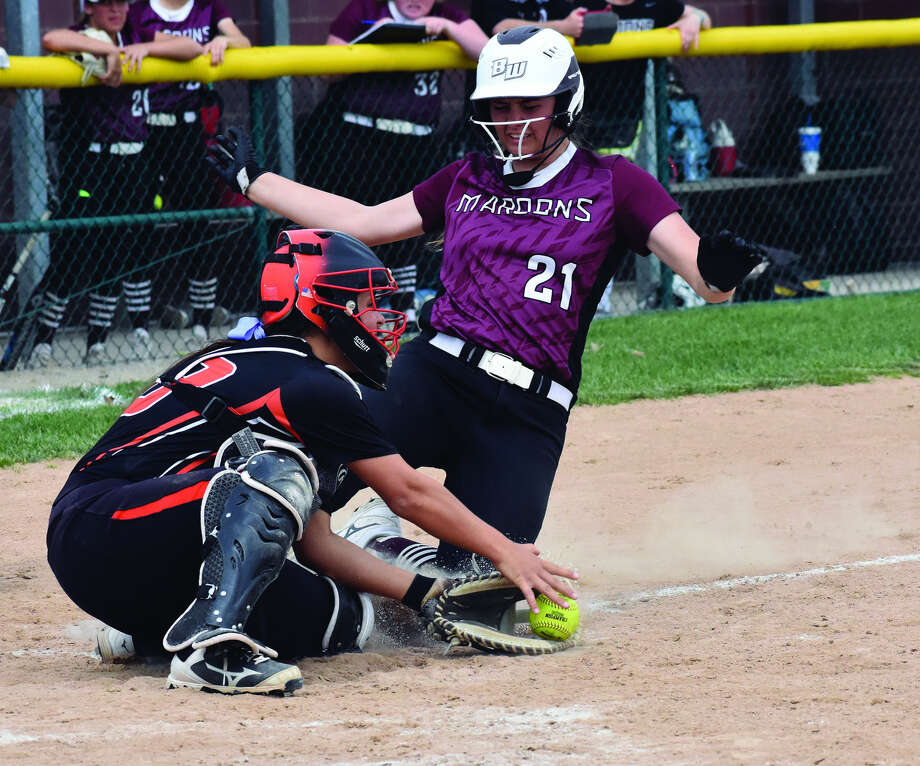 Edwardsville catcher Taryn Brown, left, prepares to tag out the Belleville West runner at the plate in the first inning of Thursday's Southwestern Conference game.