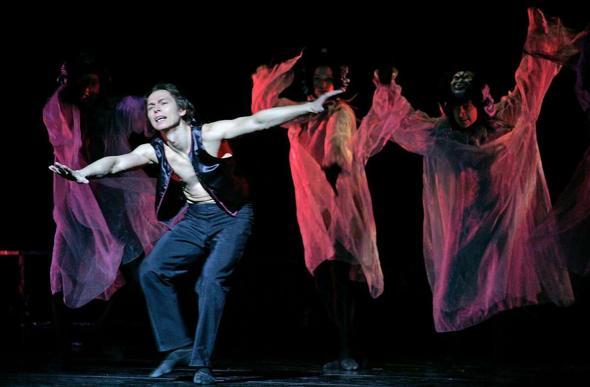"diablo_073_mac.jpg Viktor Kabaniaev performs with the Masks. The Diablo Ballet Company, dress rehearsals for their upcoming production of ,""Carmen"", at Zellerbach Hall, UC Berkeley. 1/15/05 Berkeley, Ca Michael Macor / San Francisco Chronicle"