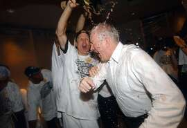 Steve Kerr douces coach Gregg Popovich with champagne during post game locker room celebration game 6 of the NBA Finals held Sunday June 15, 2003 at the SBC Center in San Antonio,Tx. PHOTO BY EDWARD A. ORNELAS /STAFF