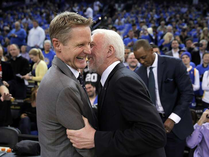 Warriors head coach Steve Kerr shares a moment with Gregg Popovich before the first half of the Golden State Warriors game against the San Antonio Spurs at Oracle Arena in Oakland, Calif., on Monday, January 25, 2016.