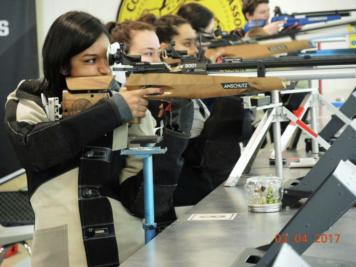 In this March 4, 2017, photo provided by the New York State Public High School Athletic Association, students compete in the association's air rifle championships at the U.S. Military Academy in West Point, N.Y. A New York lawmaker is taking aim at riflery and archery programs in schools, contending they promote a ?