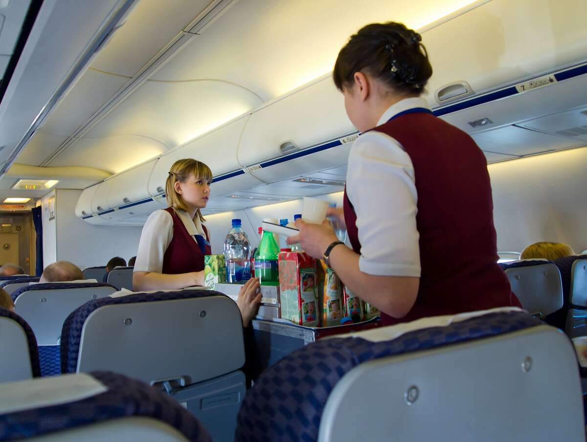 A new survey of airline flight attendants indicates that cabin crews regularly endure sexual harassment and assault by abusive passengers. (Dreamstime/TNS)