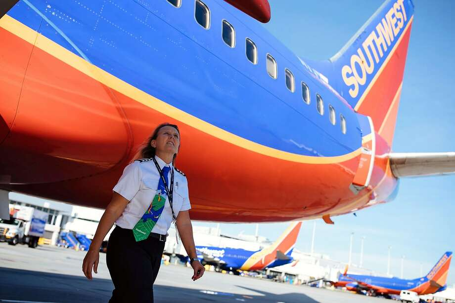 Southwest Airlines 1st Officer Wendy Mora performs a general inspection at Oakland International Airport. Photo: Mason Trinca / Special To The Chronicle