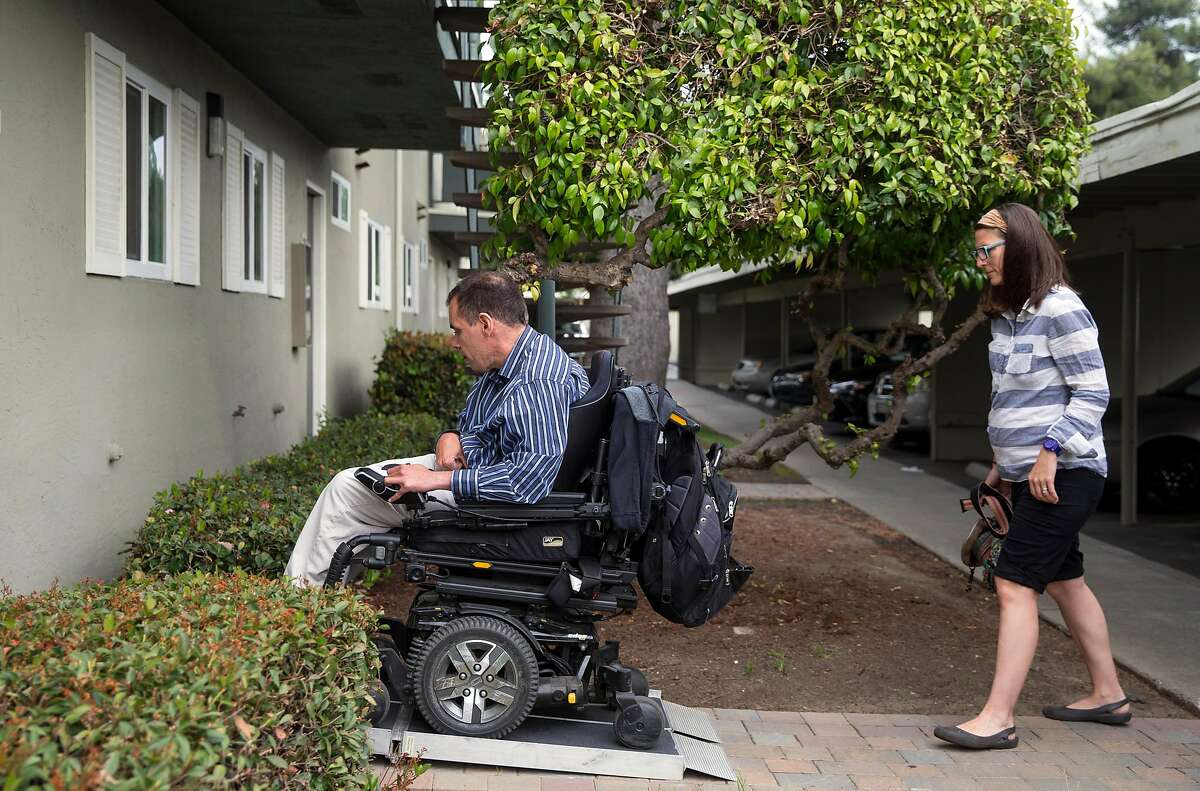 Jessica Quiambo, a behavioral analyst, follows her patient Ken Brown, 41, into his home before holding a session in Fremont, Calif. Saturday, May 5, 2018.