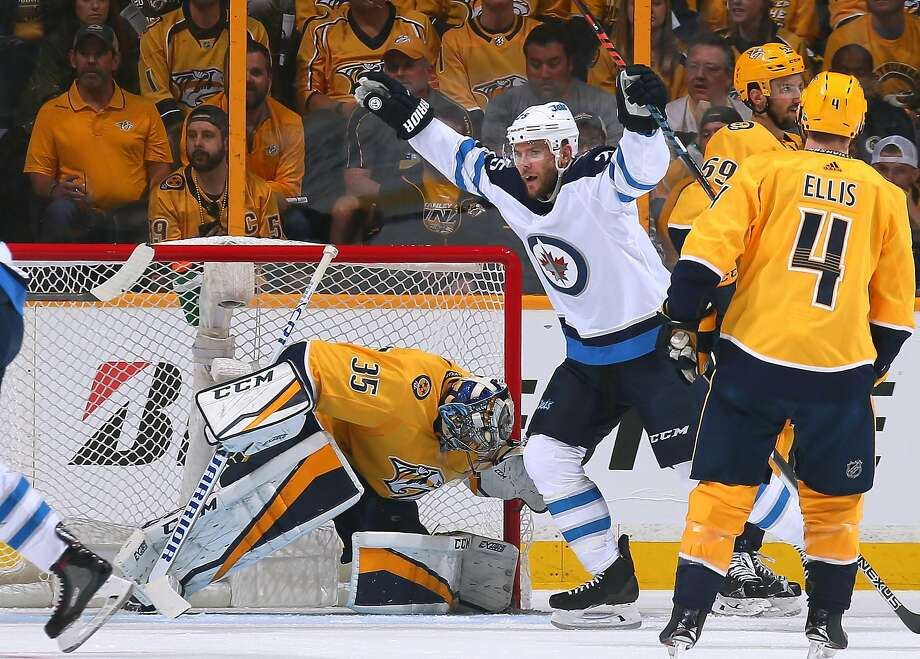 Paul Stastny of the Jets celebrates scoring against Predators goalie Pekka Rinne in the first period. Rinne was pulled after allowing goals 2:06 apart. Photo: Frederick Breedon / Getty Images