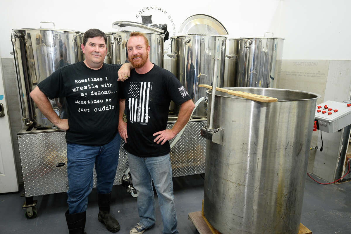 From left, Aaron Pachlofer and Jamie Ehl pose for a photo before starting to brew the first batch beer that will be sold at the newly opened Eccentric Brewing Co., May 9, 2018, at their facility on Cotton Flat Road in Midland. James Durbin/Reporter-Telegram