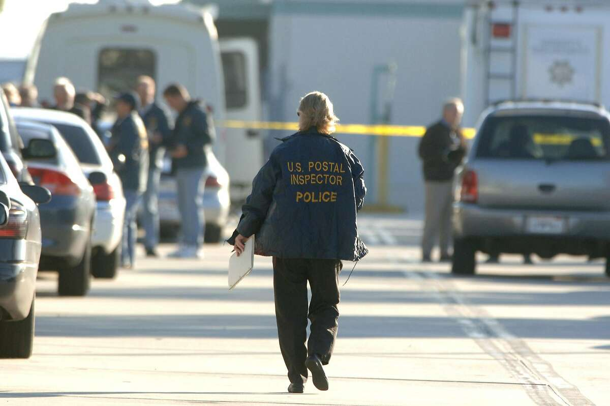 Law officers investigate a 2006 shooting at a U.S. Postal Service distribution center in Goleta.