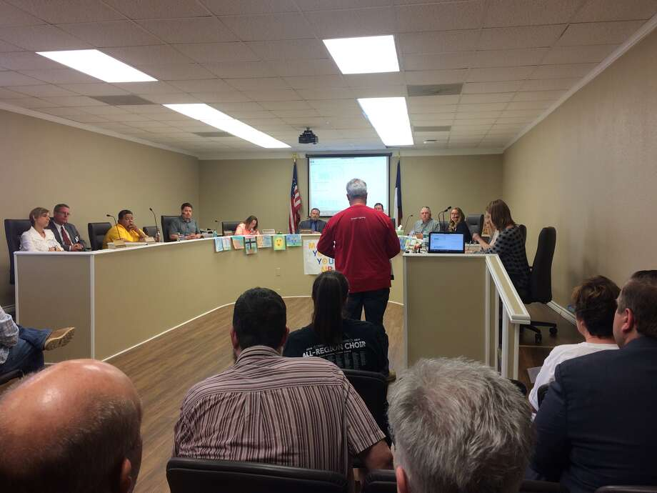 Ray Smalling, standing, shares with the Big Spring ISD board his support of campus carry policy changes Thursday during a public comment period. Photo: Simone Jasper/Reporter-Telegram