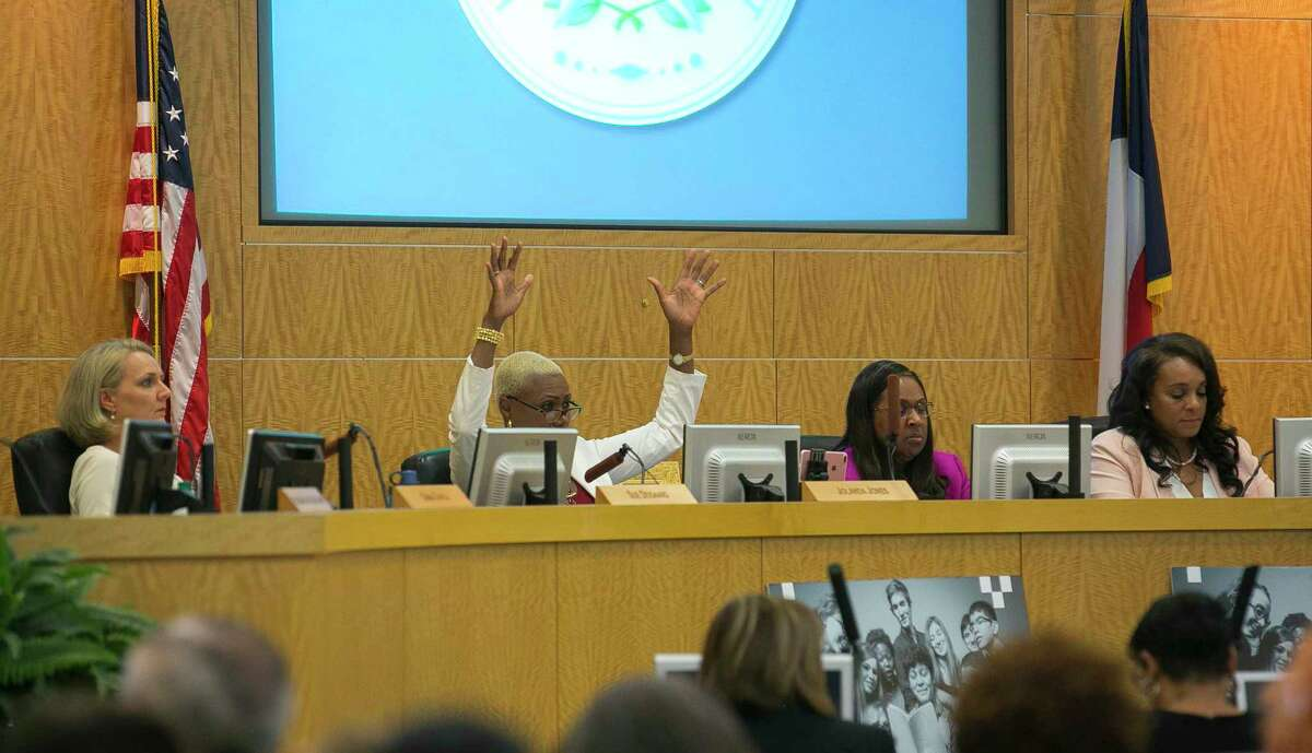 Trustee Jolanda Jones raises her hands in agreement with a public commenter during a Houston Independent School District board meeting, Thursday, May 10, 2018, in Houston.