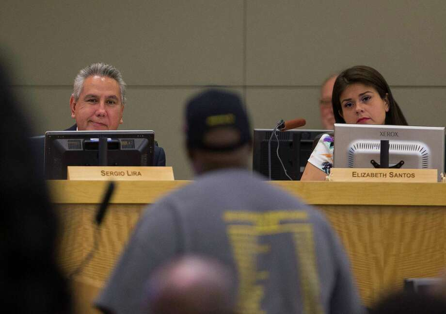 Board members Sergio Lira and Elizabeth Santos listen to Gerry Monroe make a public comment during a Houston Independent School District board meeting, Thursday, May 10, 2018, in Houston. Santos proposed an amendment that led to Thursday's salary increase. Photo: Mark Mulligan, Houston Chronicle / © 2018 Houston Chronicle