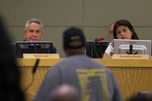 Board members Sergio Lira and Elizabeth Santos listen to Gerry Monroe make a public comment during a Houston Independent School District board meeting, Thursday, May 10, 2018, in Houston.