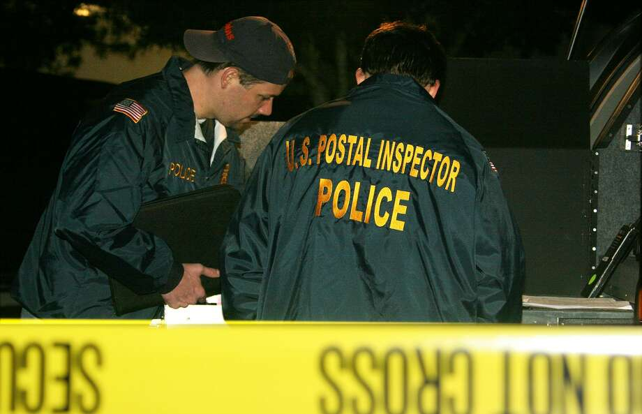 U.S. postal inspectors confer at an emergency command post in Goleta after a shooting rampage. Photo: Michael A. Mariant / Associated Press 2006 / AP