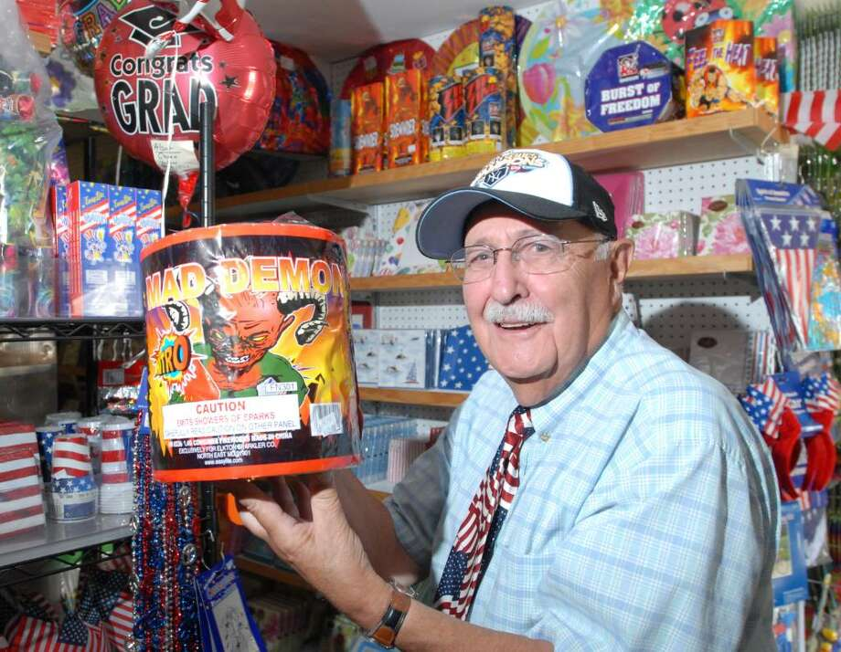 Mike Salerno poses holding a package of ground fountain display fireworks at the Party, Paper, & Things store he runs with his family in Cos Cob, Thursday afternoon, July 1, 2010.  Salerno said his store sells display fireworks year round and does good business during Chinese New Year and Bastille Day celebrations. Photo: Bob Luckey / Greenwich Time