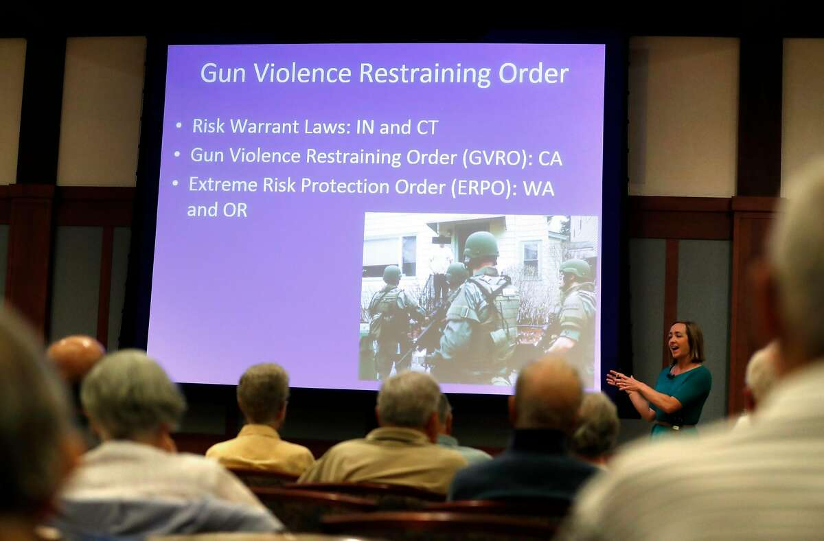 Psychiatrist Amy Barnhorst gives a lecture on mental illness and gun violence at University Retirement Community in Davis on May 10, 2018.