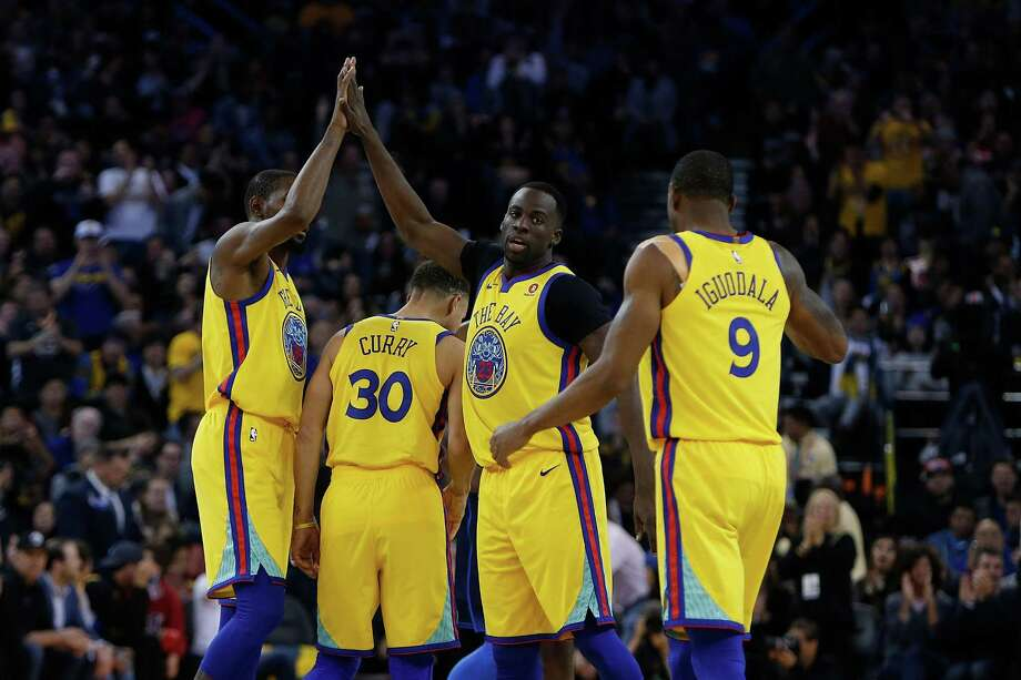 Kevin Durant, Stephen Curry, Draymond Green and Andre Iguodala celebrate during a game against the Oklahoma City Thunder at Oracle Arena on February 24, 2018. Photo: Lachlan Cunningham / Getty Images / 2018 Lachlan Cunningham