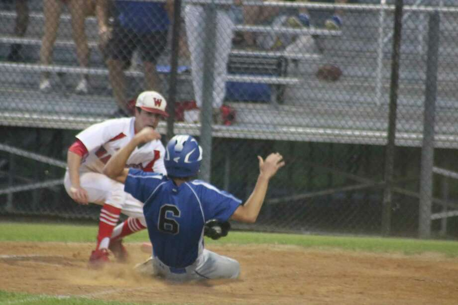 FBCA pitcher Jake Sweeney applies the tag on Colby Todd at home plate, preventing Austin Veritas from scoring a tying run in the fourth inning Thursday night. Veritas stranded eight in scoring position in addition to this out at the plate. Photo: Robert Avery