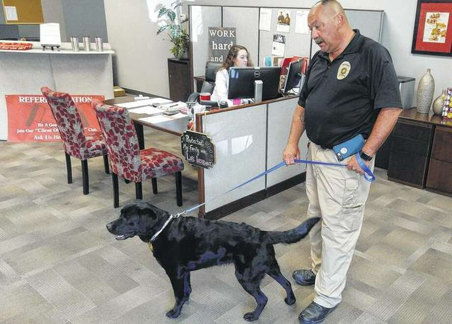Division of Arson Investigation Director Terry Ooms and 6-year-old arson dog Jules get ready Thursdayfor a demonstration of how accurate an arson dog can be.