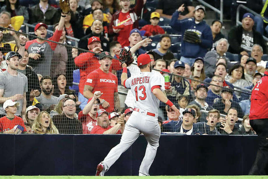 Fans react in the stands as Cardinals third baseman Matt Carpenter (13) catches a foul ball off the bat of the Padres' Travis Jankowski in the sixth inning Thursday night's game in San Diego. Photo:       Gregory Bull | AP Photo