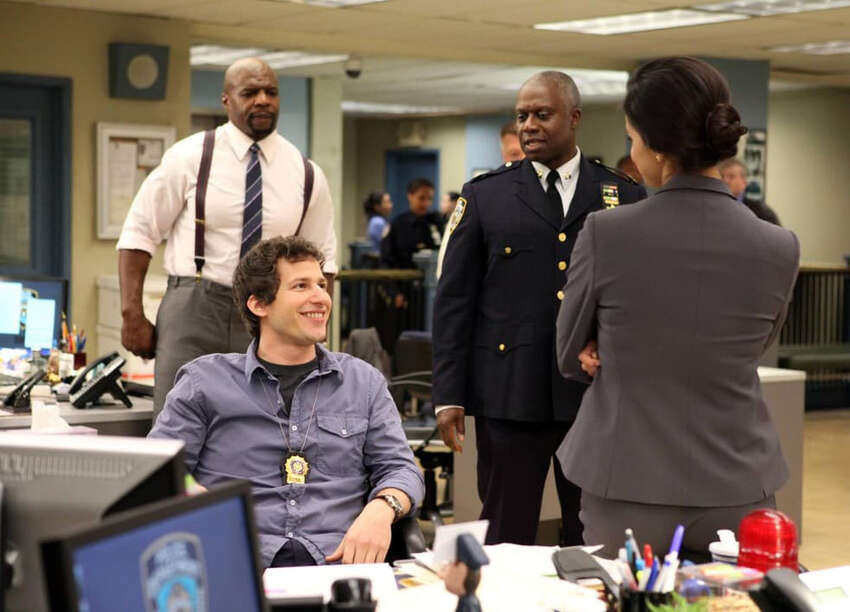 FILE - Actors Andy Samberg, Terry Crews, Andre Braugher and Stephanie Beatriz in a scene from