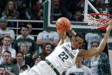 Michigan State's Miles Bridges (22) dunks against Purdue's Dakota Mathias (31) and Vincent Edwards, right rear, as Michigan State's Kenny Goins (25) and Purdue's P.J. Thompson (11) watch during the first half of an NCAA college basketball game, Saturday, Feb. 10, 2018, in East Lansing, Mich. (AP Photo/Al Goldis)