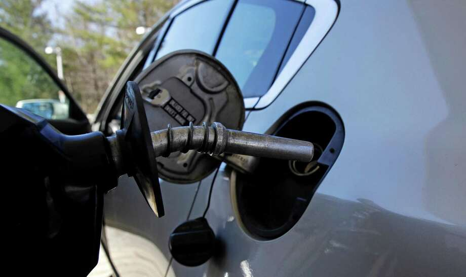 A car is filled with gasoline at a station in Windham, N.H., Monday, April 23, 2018. (AP Photo/Charles Krupa) Photo: Charles Krupa / Associated Press / Copyright 2018 The Associated Press. All rights reserved.